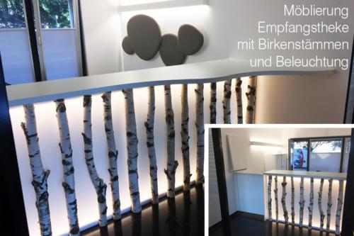 Möblierung-Empfangstheke-mit-Birkenstämmen-und-Beleuchtung